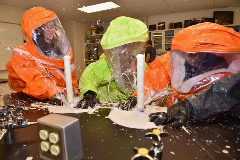 Students in protective clothing during the Joint Science and Technology Institute at Albuquerque
