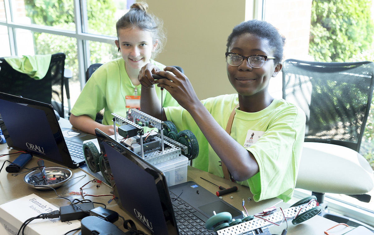 Two young females build a robot during the Oak Ridge Robotics Academy