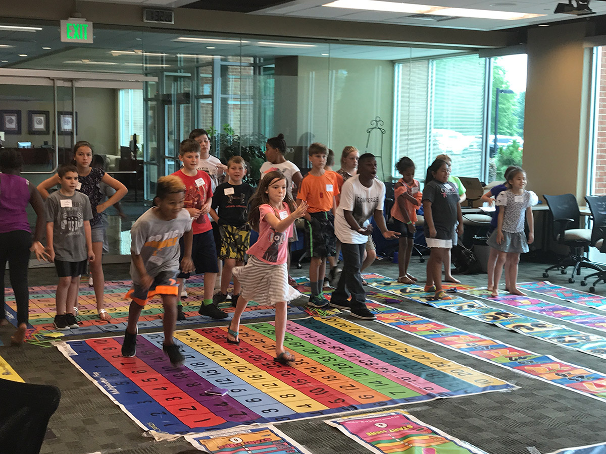 Elementary school students participate in the Math and Movement workshop at ORAU