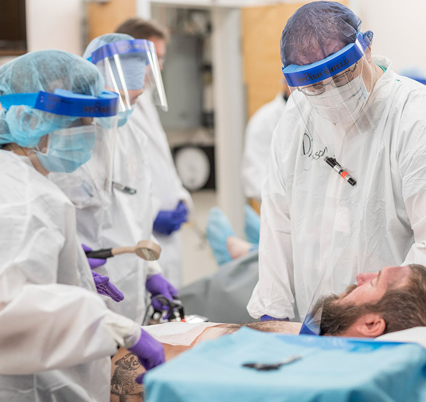 Emergency medical staff assess and treat contaminated patient