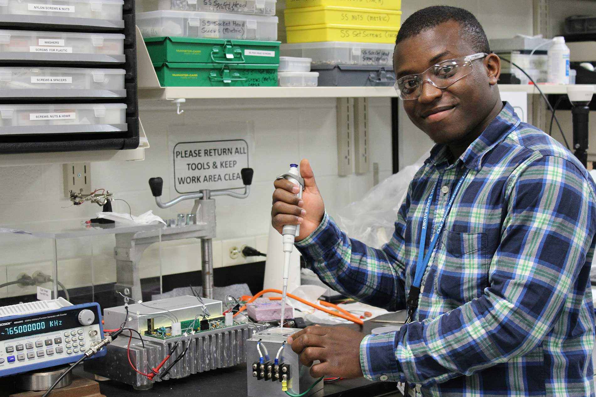 Male student researcher conducting experiment in laboratory